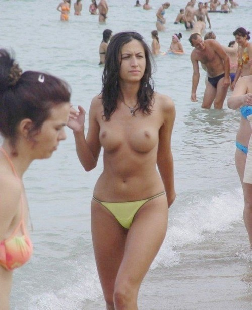 Are Picturea of topless women on beach with you